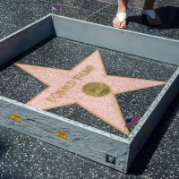 "This Tuesday, July 19, 2016 photo provided by Nick Stern shows a six-inch high, concrete-appearing 'wall,' created by an artist known as Plastic Jesus, surrounding the Hollywood Walk of Fame star of Donald Trump in Los Angeles. It appeared the day the former reality TV star and entrepreneur secured the Republican nomination for president. Tourists snapped photos of the wall, topped with razor wire and plastered with ""keep out"" signs. The tiny wall was gone by Wednesday morning. (Nick Stern via AP)/LA103/16202714153854/AP PROVIDES ACCESS TO THIS HANDOUT PHOTO TO BE USED SOLELY TO ILLUSTRATE NEWS REPORTING OR COMMENTARY ON THE FACTS OR EVENTS DEPICTED IN THIS IMAGE. THIS IMAGE MAY BE USED ONLY FOR 14 DAYS FROM THE TIME OF TRANSMISSION; NO ARCHIVING; NO LICENSING; MANDATOR/1607202210"